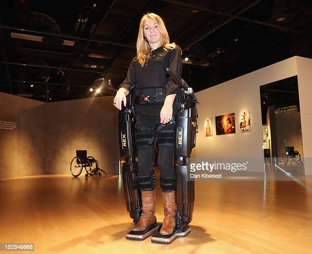 Sophie Morgan walks with the aid of 'Rex' a Robotic Exoskeleton at the Welcome Trust on September 19 2012 in London England The system allows...