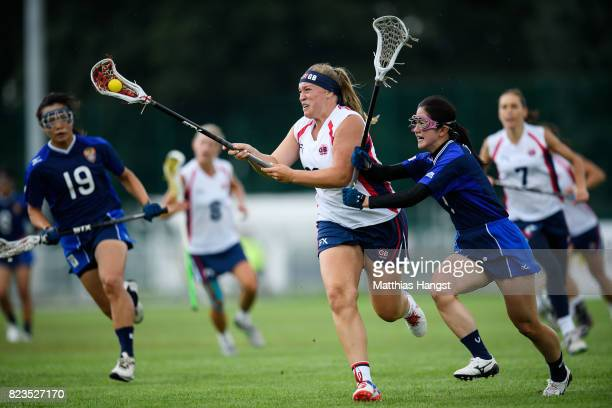 Sophie Morrill of Great Britain is challenged by Nozomi Tanaka of Japan during the Lacrosse Women's match between Great Britain and Japan of The...