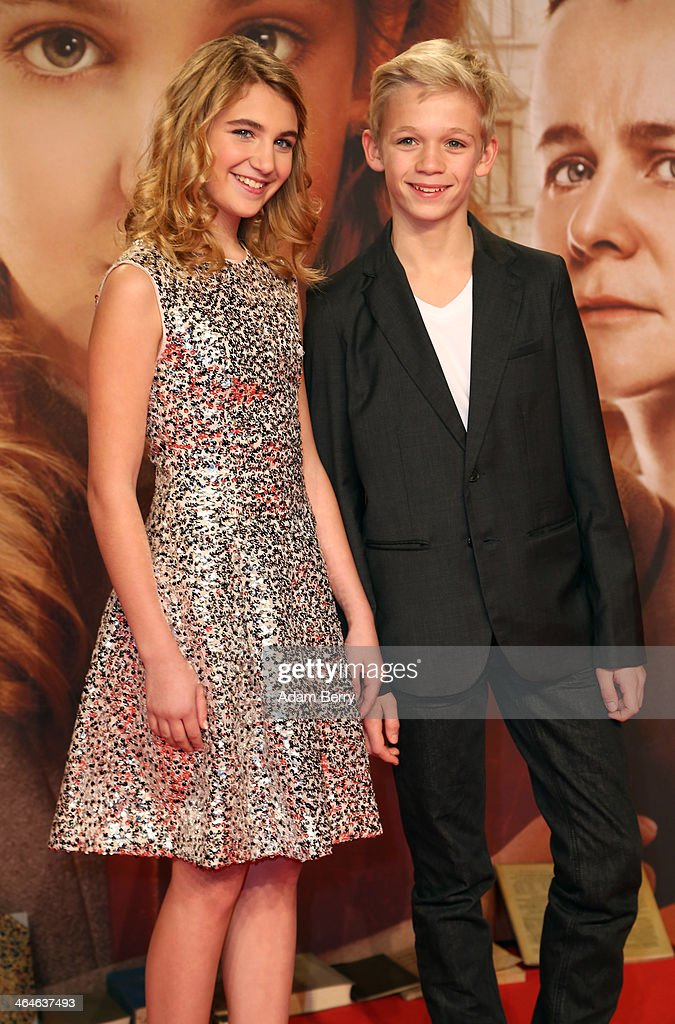 Sophie Nelisse (L) and Nico Liersch arrive for the German premiere of the film 'The Book Thief' (Die Buecherdiebin) at Zoo Palast on January 23, 2014 in Berlin, Germany.
