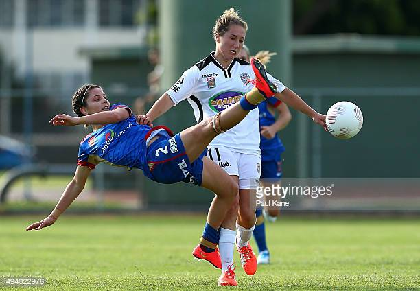 Sophie Nenadovic of the Jets and Emily Henderson of the Glory contest for the ball during the round two WLeague match between Perth Glory and the...