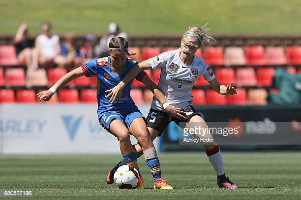 Sophie Nenadovic of the Jets is contested by Ellie Carpenter of the Wanderers during the round eight WLeague match between Newcastle and Western...