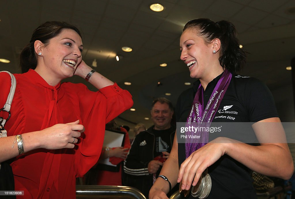 Sophie Pascoe (R) is greeted by her sister Rebecca Richards (L) during the New Zealand Paralympians arrival home at Auckland International Airport on September 12, 2012 in Auckland, New Zealand.