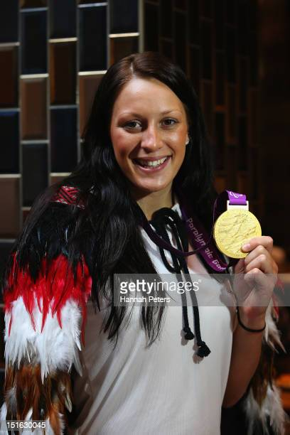 Sophie Pascoe of New Zealand poses with one of her gold medals during the New Zealand team function at Olympic Park on September 9 2012 in London...