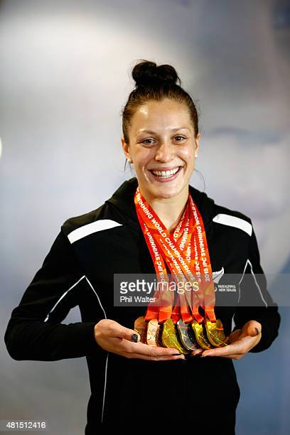 Sophie Pascoe of the New Zealand ParaSwimming team holds up her haul of medals after arriving home from the IPC Swimming World Championships held in...