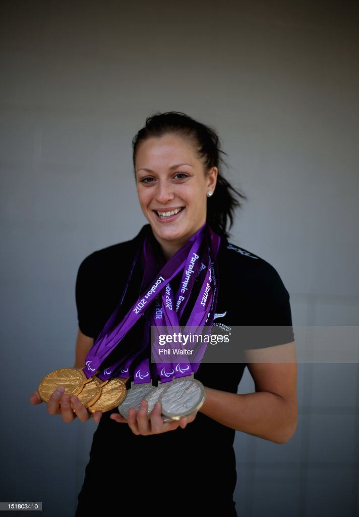 Sophie Pascoe poses for a portrait with her haul of six medals from the London Paralympics, during the New Zealand Paralympians arrival home at Auckland International Airport on September 12, 2012 in Auckland, New Zealand.