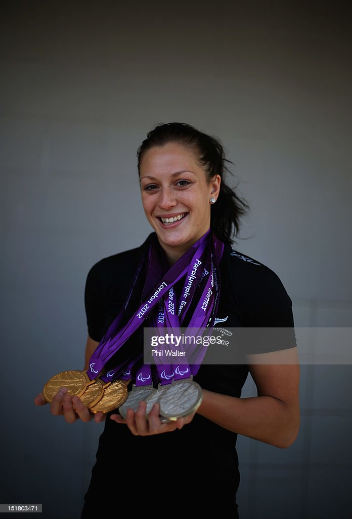 <a gi-track='captionPersonalityLinkClicked' href=/galleries/search?phrase=Sophie+Pascoe&family=editorial&specificpeople=5521857 ng-click='$event.stopPropagation()'>Sophie Pascoe</a> poses for a portrait with her haul of six medals from the London Paralympics, during the New Zealand Paralympians arrival home at Auckland International Airport on September 12, 2012 in Auckland, New Zealand.