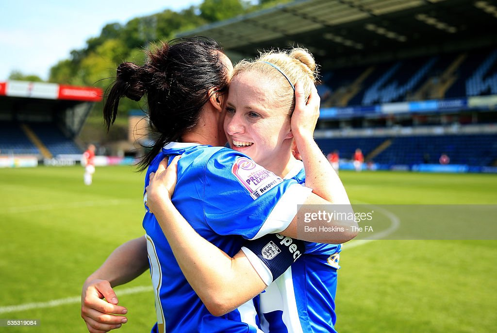 Sophie Perry (L) and Kirsty Barton (R) of Brighton celebrate at the final whistle during the WPL Playoff match between Brighton & Hove Albion WFC and Sporting Club Albion LFC at Adams Park on May 29, 2016 in High Wycombe, England.