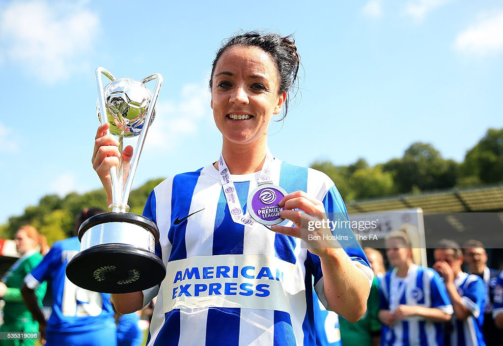Sophie Perry of Brighton poses with the trophy following her teams victory in the WPL Playoff match between Brighton & Hove Albion WFC and Sporting Club Albion LFC at Adams Park on May 29, 2016 in High Wycombe, England.