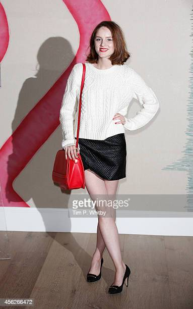 Sophie Rundle poses for a photo ahead of a preview screening of the second series of 'Peaky Blinders' at Ham Yard Hotel on September 28 2014 in...