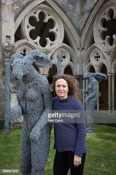 Sophie Ryder poses for a photograph with a hare that has been installed at Salisbury Cathedral as part of an exhibition by the artist on February 4...