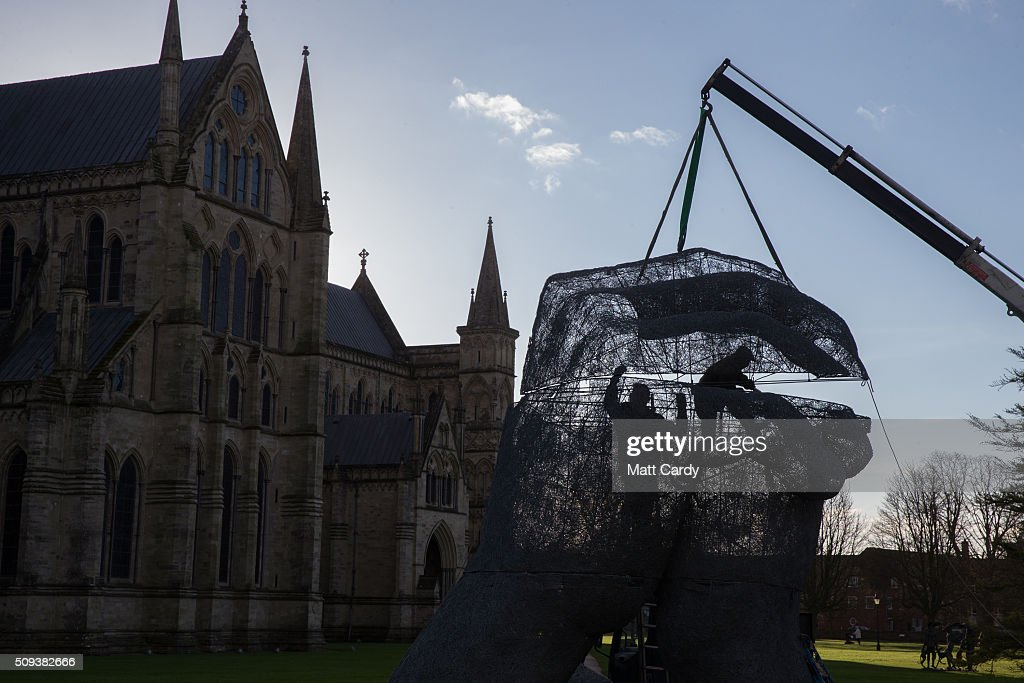 Sophie Ryder's sculpture The Kiss, is installed in the grounds of Salisbury Cathedral as part of an exhibition by the artist on February 10, 2016 in Salisbury, England. The solo exhibition, Relationships, featuring life-sized Minotaurs, Lady Hares and giant 20ft high clasped hands installed in and around the historic Cathedral, opens on February 12 and runs until July 3