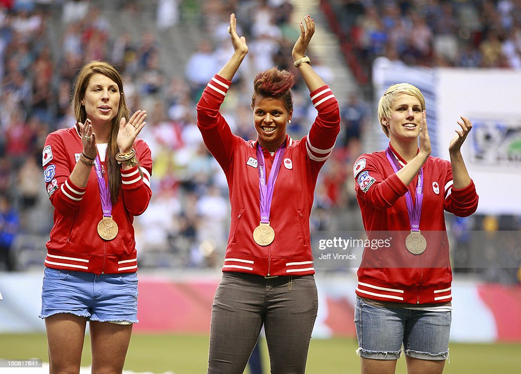 Sophie Schmidt, Karina LeBlanc and Emily Zurrer (r to l), members of Canada's Olympic bronze-medal winning soccer team, are honoured before the MLS game between FC Dallas and Vancouver Whitecaps August 15, 2012 in Vancouver, British Columbia, Canada.