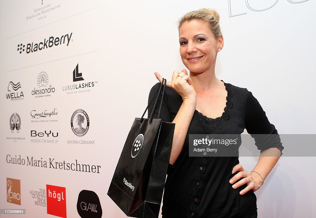<a gi-track='captionPersonalityLinkClicked' href=/galleries/search?phrase=Sophie+Schuett&family=editorial&specificpeople=593393 ng-click='$event.stopPropagation()'>Sophie Schuett</a> poses at the Blackberry Style Lounge during Mercedes-Benz Fashion Week in Berlin on July 3, 2013 in Berlin, Germany.