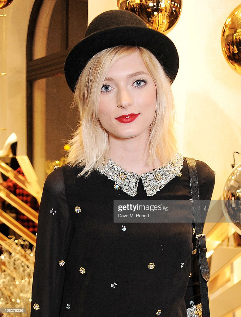 Sophie Sumner attends a Christmas drinks hosted by designer Nicholas Kirkwood to celebrate his partnership with Chambord black raspberry liquer, and launch the limited edition shoe 'The Chambord' at the Nicholas Kirkwood Mount Street store on December 12, 2012 in London, England.