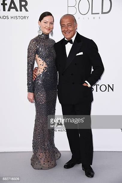 Sophie Taylor and Fawaz Gruosi arrive at amfAR's 23rd Cinema Against AIDS Gala at Hotel du CapEdenRoc on May 19 2016 in Cap d'Antibes France
