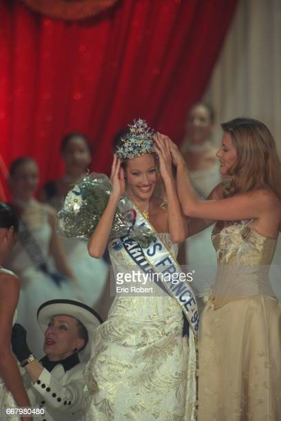 Sophie Thalmann Miss France 1998 hands her crown to the winner Mareva Galantier Miss Tahiti