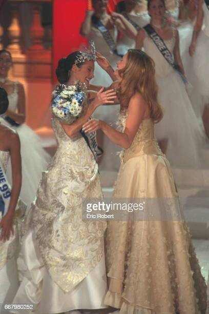 Sophie Thalmann Miss France 1998 hands on her crown to the winner Mareva Galentier Miss Tahiti