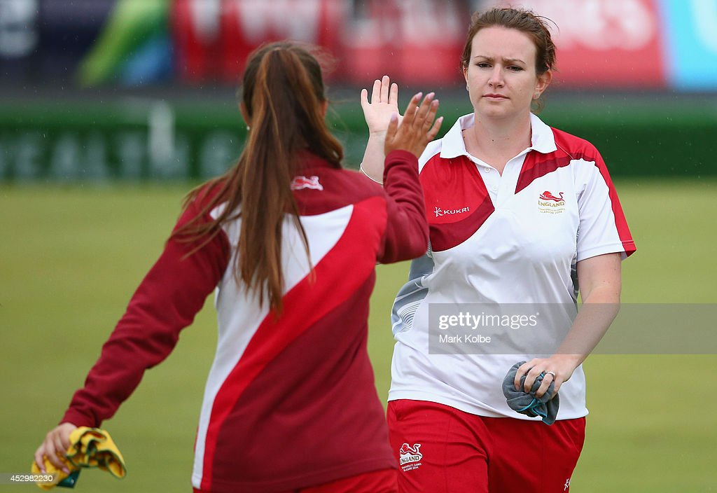 Sophie Tolchard of England celebrates with Sian Gordon of England during the women's triples final match between England and Australia at Kelvingrove Lawn Bowls Centre during day eight of the Glasgow 2014 Commonwealth Games on July 31, 2014 in Glasgow, United Kingdom.