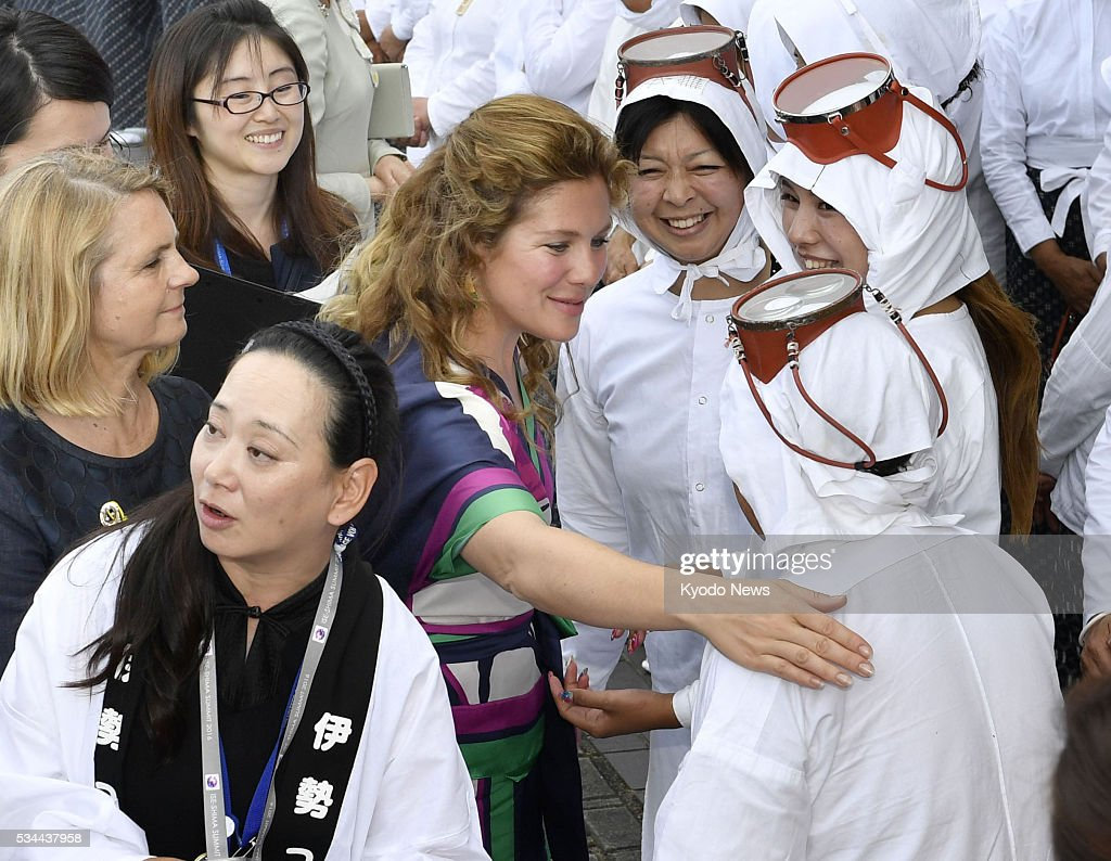 Sophie Trudeau (C), the wife of Canadian Prime Minister Justin Trudeau, greets 'ama' female free divers at Mikimoto Pearl Island in Toba, Mie Prefecture, on May 26, 2016, as the visiting spouses of the Group of Seven leaders experienced the natural beauty and traditions of central Japan on the sidelines of the Ise-Shima Summit.