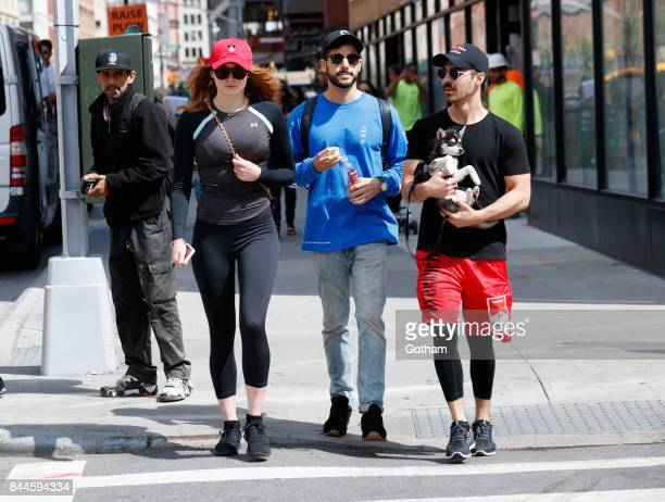Sophie Turner and Joe Jonas carrying their new puppy 'Direwolf' out and about for a stroll on September 8 2017 in New York City