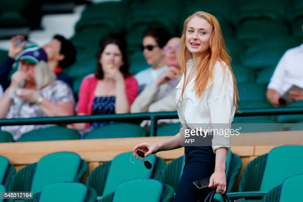 Sophie Turner arrives in the royal box on centre court during the women's semifinal matches on the eleventh day of the 2016 Wimbledon Championships...