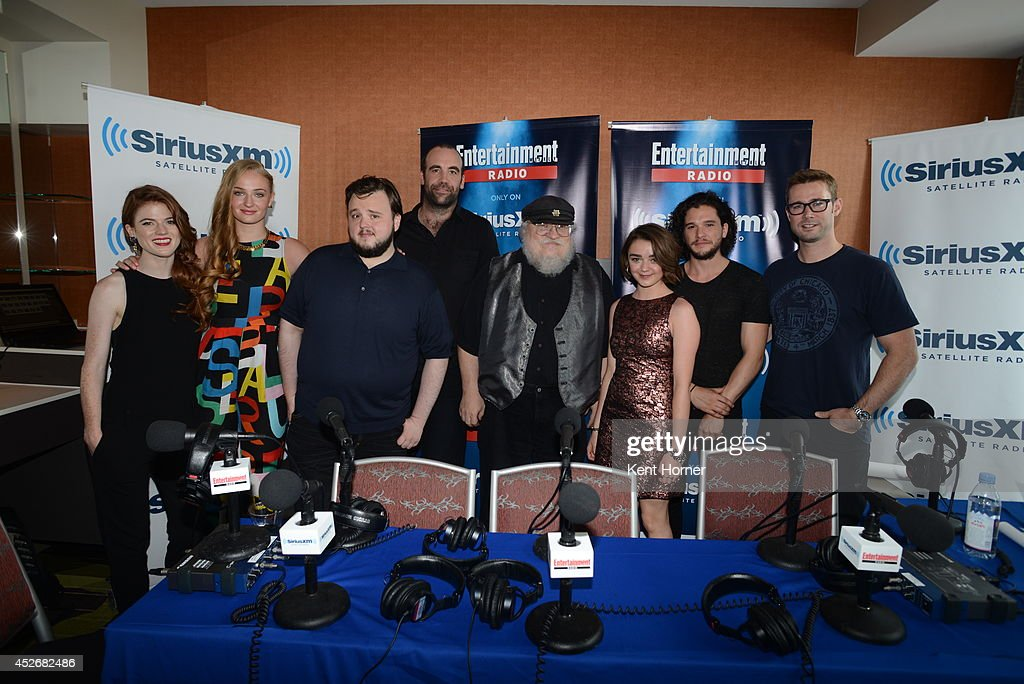 Sophie Turner, Rose Leslie, John Bradley, Rory McCann, George RR Martin, Maisie Williamss and Kit Harrington pose with radio host Matt Bean after being interviewed on SiriusXM's Entertainment Weekly Radio channel from Comic-Con 2014 at The Hard Rock Hotel on July 25, 2014 in San Diego, California.