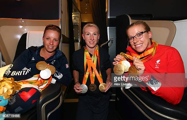 Sophie Wells Georgie Hermitage and Hannah Cockcroft of the Paralympics GB Team pose with their medals onboard the British Airways flight BA2016 from...