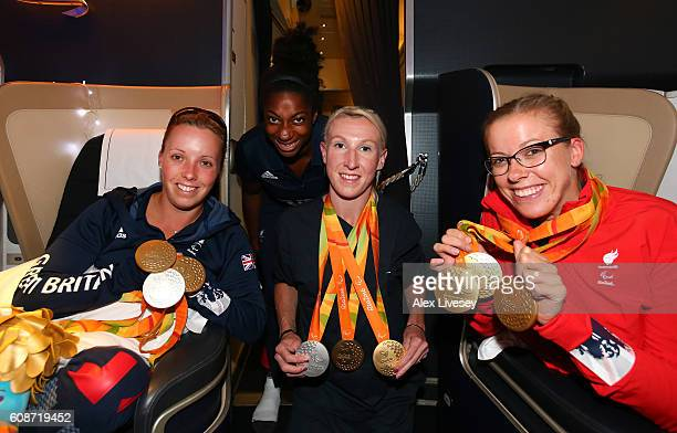 Sophie Wells Kadeena Cox Georgie Hermitage and Hannah Cockcroft of the Paralympics GB Team pose with their medals onboard the British Airways flight...