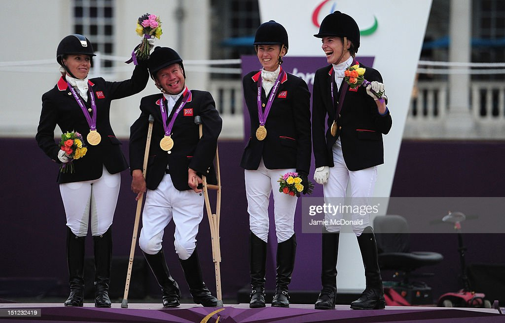 Sophie Wells, Lee Pearson, Deborah Criddle and Sophie Christiansen of Great Britain win Team Gold during the Equestrian Event on day 6 of the London 2012 Paralympic Games at Greenwich Park on September 4, 2012 in London, England.