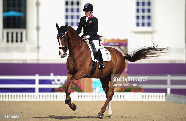 Sophie Wells of Great Britain rides Pinocchio to win Silver during the Equestrian Dressage Individual Freestyle Test Grade IV on day 6 of the London...