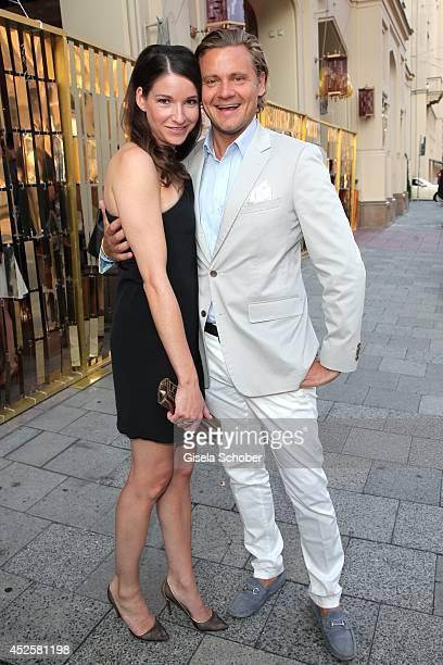 Sophie Wepper and David Meister attend the Eclat Dore summer party at Hotel Vier Jahreszeiten Kempinski on July 23 2014 in Munich Germany