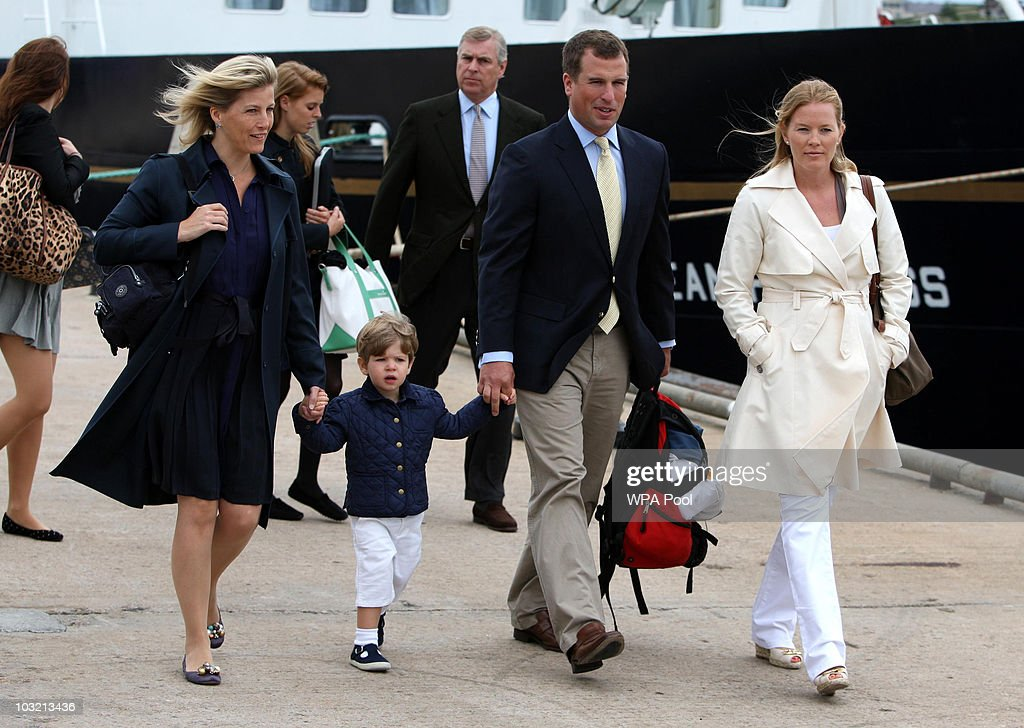 Sophie,The Countess of Wessex, her son James, Viscount Severn, Peter Phillips and Autumn Phillips followed by (back left to right) Princess Eugenie, Princess Beatrice and their father Prince Andrew, The Duke of York disembark the Hebridean Princess boat after a family holiday around the Western Isles of Scotland, on August 02, 2010 in Scrabster, Scotland.