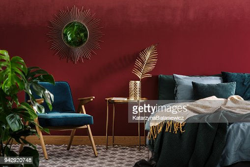 Sophisticated red bedroom with mirror : Stock Photo