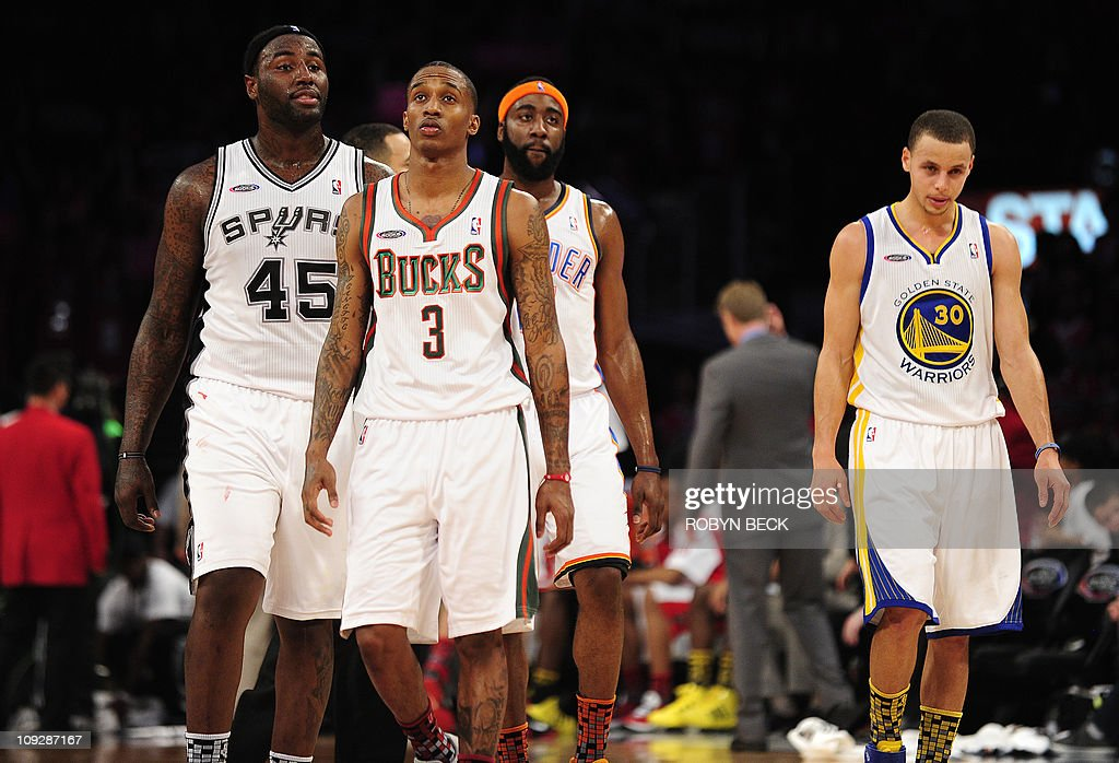 Sophmore Team members from left San Antonion Spurs center DeJuan Blair, Milwaukee Bucks guard Brandon Jennings, Oaklahoma City Thunder guard James Harden and Golden State Warriors guard Stephen Curry (R) walk together during the NBA All Star - Rookie Challenge at the Staples Center in Los Angeles February 18, 2011. The Rookies won 148-140. AFP PHOTO / Robyn Beck