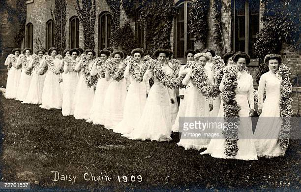Sophomore class students of Vassar College parade in white dresses and carry a large chain of daisies during the annual Daisy Chain procession at...