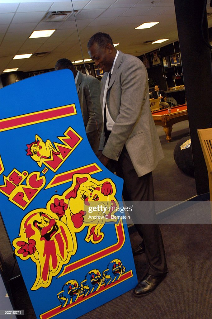 Sophomore Team coach Bob McAdoo plays a game of Ms. Pac-Man in the locker room prior to the got milk? Rookie Challenge during 2005 NBA All-Star Weekend at Pepsi Center on February 18, 2005 in Denver, Colorado.