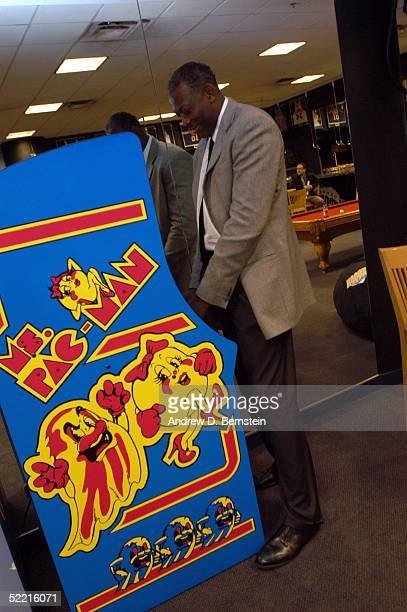 Sophomore Team coach Bob McAdoo plays a game of Ms PacMan in the locker room prior to the got milk Rookie Challenge during 2005 NBA AllStar Weekend...