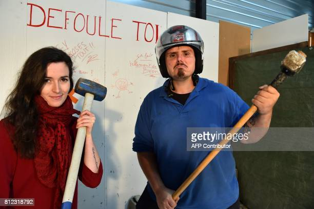 Sophrologist Jenniefer Le Guen and professional mover Nicolas Sergeant pose on June 30 in NoyalChatillonsurSeiches western France Spraying plates...