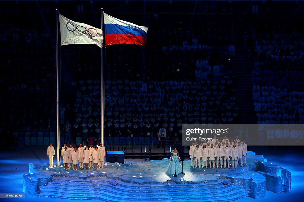 Soprano <a gi-track='captionPersonalityLinkClicked' href=/galleries/search?phrase=Anna+Netrebko&family=editorial&specificpeople=732328 ng-click='$event.stopPropagation()'>Anna Netrebko</a> sings as the Olympic flag is raised during the Opening Ceremony of the Sochi 2014 Winter Olympics at Fisht Olympic Stadium on February 7, 2014 in Sochi, Russia.