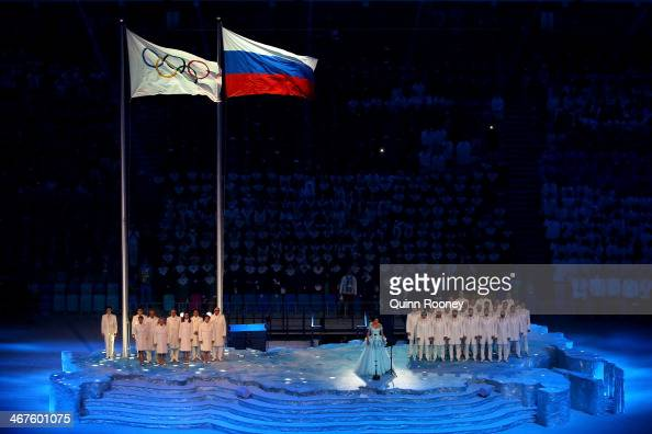 Soprano Anna Netrebko sings as the Olympic flag is raised during the Opening Ceremony of the Sochi 2014 Winter Olympics at Fisht Olympic Stadium on...