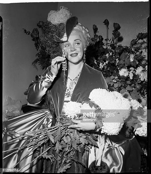Soprano Eleanor Steber displays the third act costume she wears as Marschallin in Richard Strauss' 'Der Rosenkavalier' the opera which was chosen to...