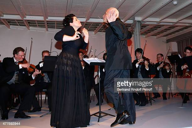 Soprano Hibla Gerzmava and Maestro Vladimir Spivakov perform during the 'Alaia' Azzedine Alaia Perfum Launch Party on May 21 2015 in Paris France
