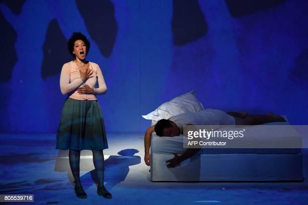 US soprano Julia Bullock as Ann Trulove and US tenor Paul Appleby as Tom Rakewell perform Igor Stravinski's opera 'The Rake's Progress' directed by...