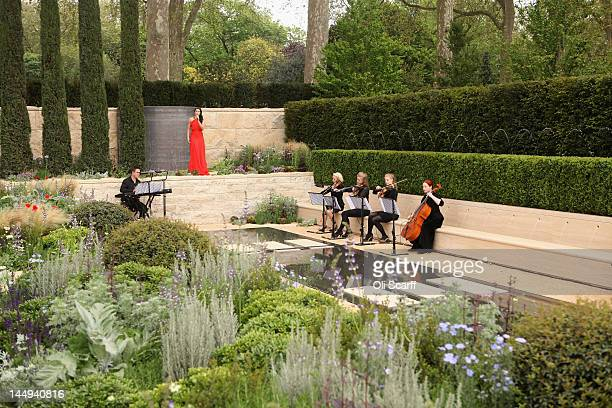 Soprano Laura Wright sings in 'The Arthritis Research UK Garden' at the Royal Horticultural Society's Chelsea Flower Show on May 21 2012 in London...