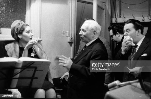 Soprano Maria Callas conductor Tullio Serafin and tenor Luigi Tagliavini in the playback room at Kingsway Hall London listening to a recording of...