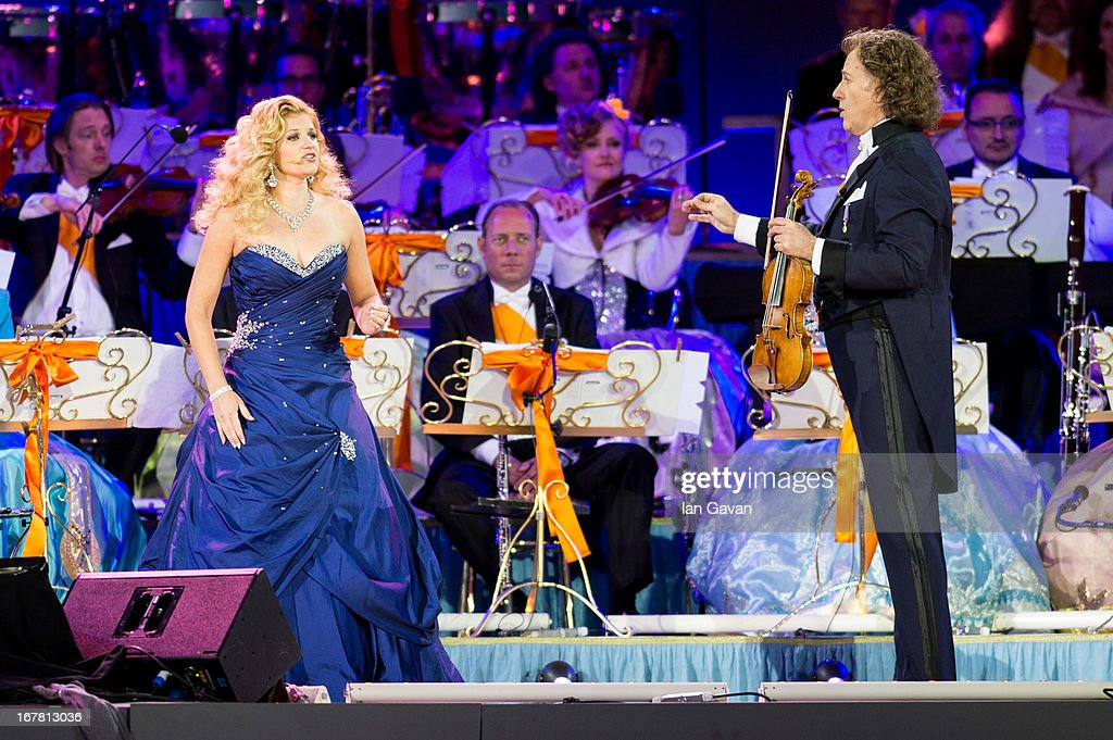 Soprano Mirusia Louwerse and Andre Rieu perform on stage at Museumplien during the inauguration of King Willem Alexander of the Netherlands as Queen Beatrix of the Netherlands abdicates on April 30, 2013 in Amsterdam, Netherlands.