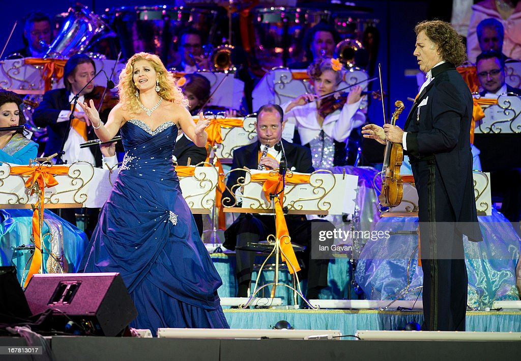 Soprano Mirusia Louwerse and Andre Rieu performs on stage at Museumplien during the inauguration of King Willem Alexander of the Netherlands as Queen Beatrix of the Netherlands abdicates on April 30, 2013 in Amsterdam, Netherlands.