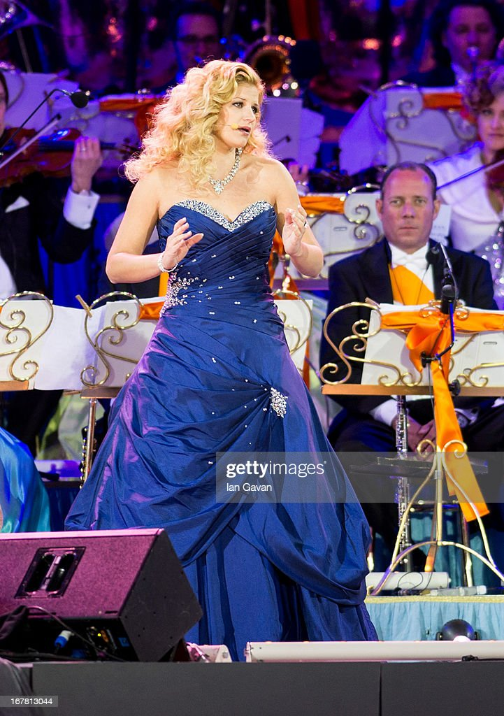 Soprano Mirusia Louwerse performs on stage with Andre Rieu at Museumplien during the inauguration of King Willem Alexander of the Netherlands as Queen Beatrix of the Netherlands abdicates on April 30, 2013 in Amsterdam, Netherlands.