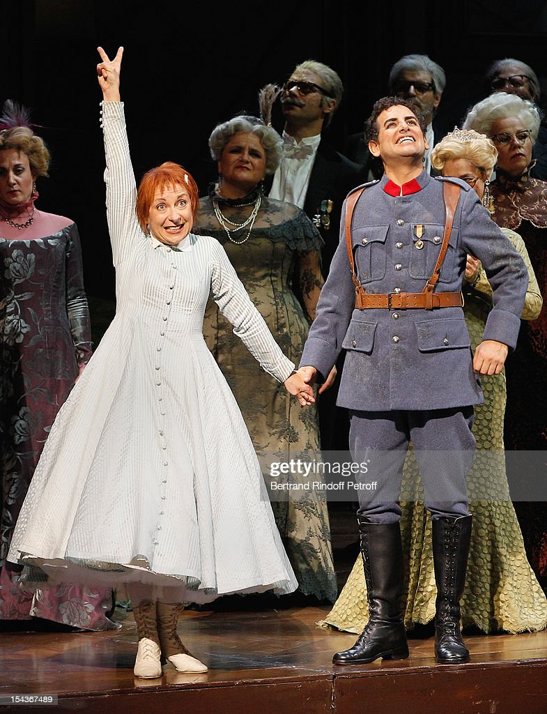 Soprano Nathalie Dessay (L) and tenor Juan Diego Florez (R) acknowledge applause after performing 'The Daughter of the Regiment', a 1840 Opera by Gaetano Donizetti, and prior to AROP Gala Dinner on October 18, 2012 in Paris, France.