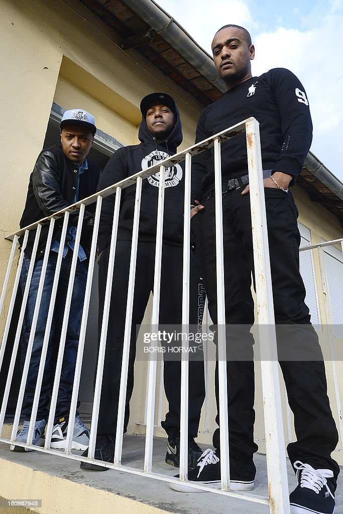 Soprano, Vincenzo and Alonzo of French rap band 'Psy4 de la rime' pose on February 6, 2013 at a recording studio in Marseille, southern France. 'Psy4 de la rime' rap band features Marseille police corruption scandal from late 2012, involving officers of the Anti Criminal Brigade (BAC) in northern Marseille, in its latest video clip entitled 'Crise de nerfs' (Nervous Breakdown), mixing TV culture and tpoical issues. Most of the officers who have been charged or suspended were arrested in early October 2012 following the discovery of cash and drugs hidden above a false ceiling in their office, and were suspected of routinely stealing drugs and cash from dealers and of holding on to cigarettes confiscated from illicit sellers.